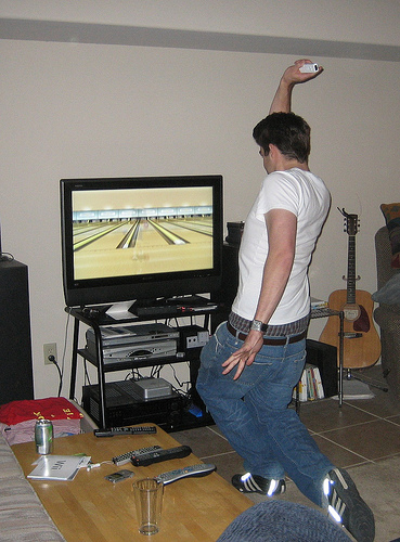 Someone playing Wii bowling