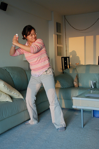 Someone playing Wii baseball